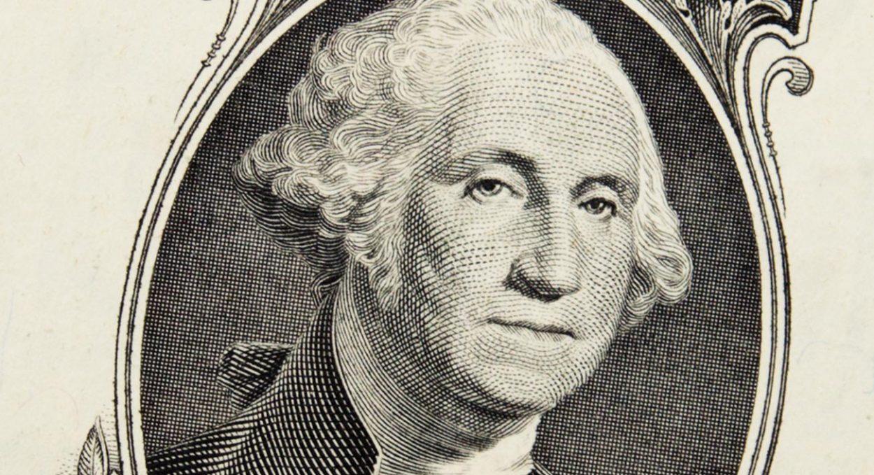 Изображение президента Джорджа Вашингтона на однодолларовой купюре.