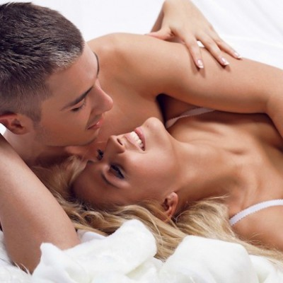 Beautiful young couple in the bedroom
