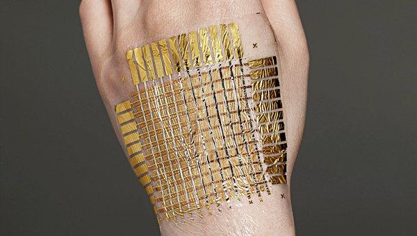 «Электронная фольга» превращает человеческую кожу в компьютер
