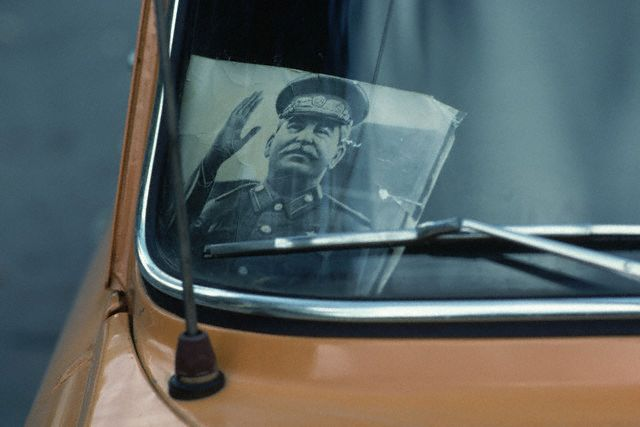 October 1981, Tbilisi, USSR --- Stalin Portrait in Taxi Window --- Image by © Marc Garanger/CORBIS